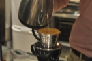 ... but he's replaced his big pour-over filters with these neat one-serve Kalita Waves.