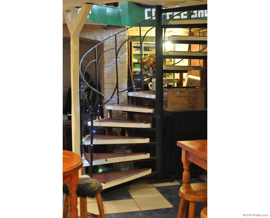 Flat Caps is actually inside a gift shop at the bottom of this spiral staircase...