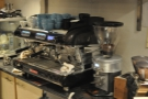 The espresso machine with a pleasing array of cups and a multitude of grinders.