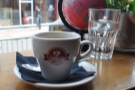 My espresso, with a glass of water, naturally. Check out the globe!