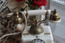 In yet another corner (by the window-bar), a wonderful vintage telephone. Nice roses too.