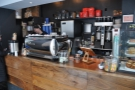 Right, let's get down to business. The till's sandwiched between espresso machine & cake...