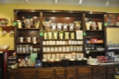 The right-hand wall is dominated by this display case, full of bags of coffee for sale.