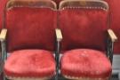 These two cinema seats are to the left as you come in. There's one more  table and that's it.