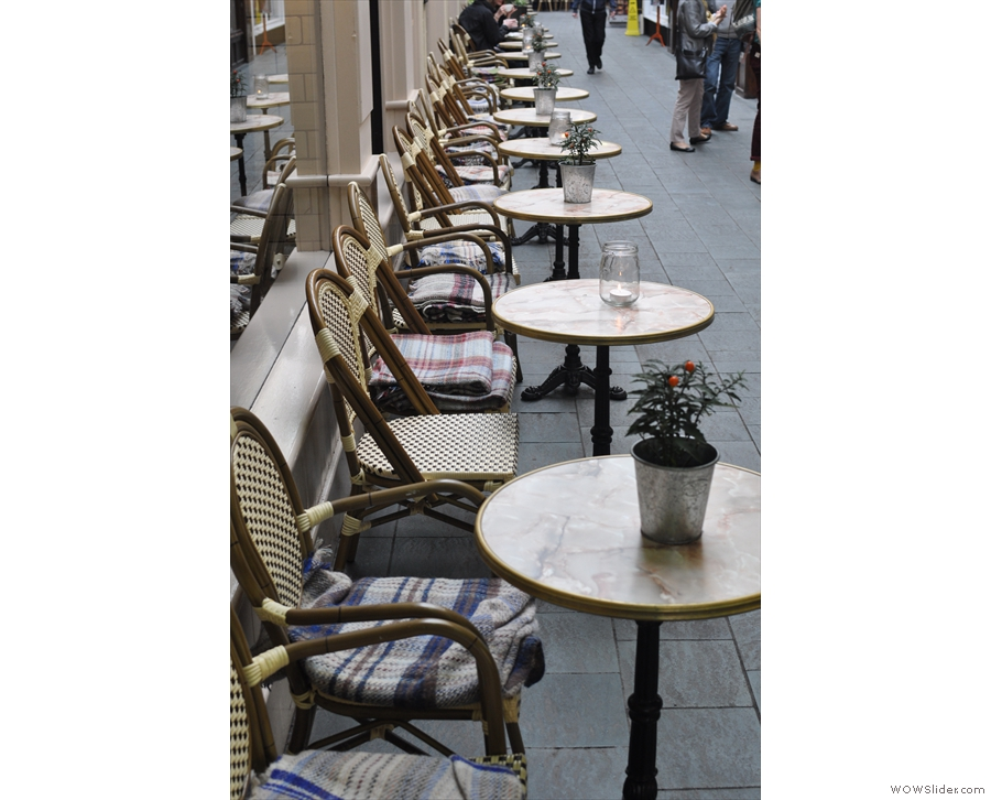 The massed ranks of tables outside Coffee Barker, giving it a very Parisian feel.