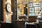 Plain brick walls, angle-poise lamps and a clock. It's always 2.30 in Coffee Barker...