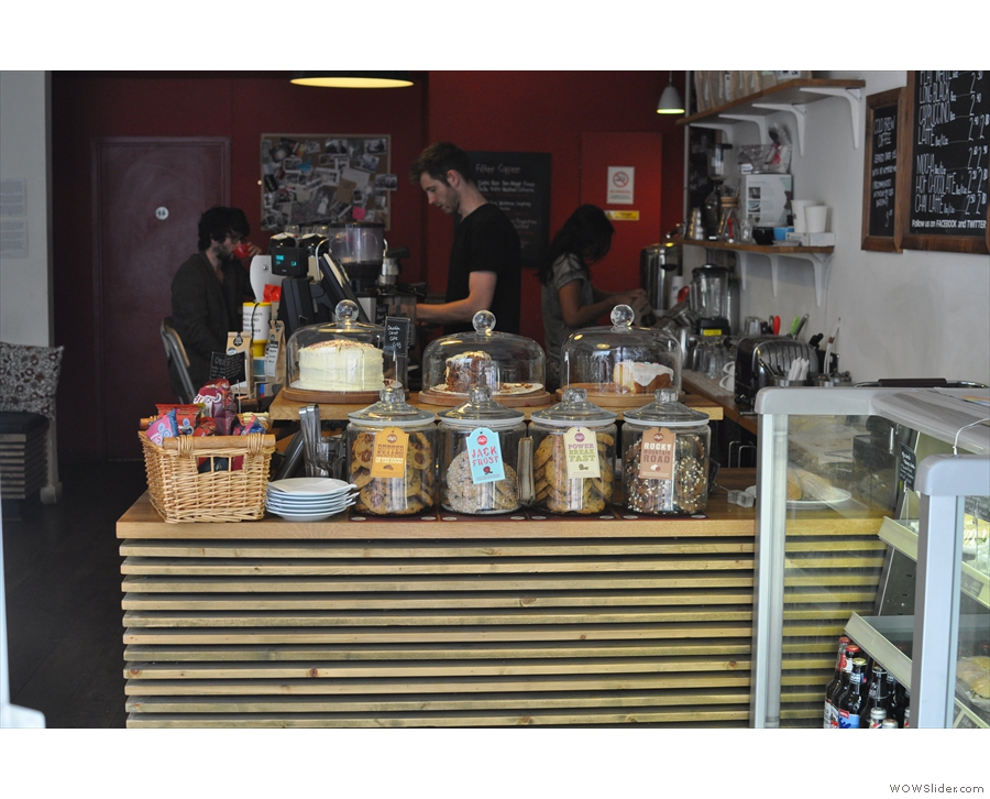 The view from the door: cake! Plus Aaran the Barista, doing what he does best.