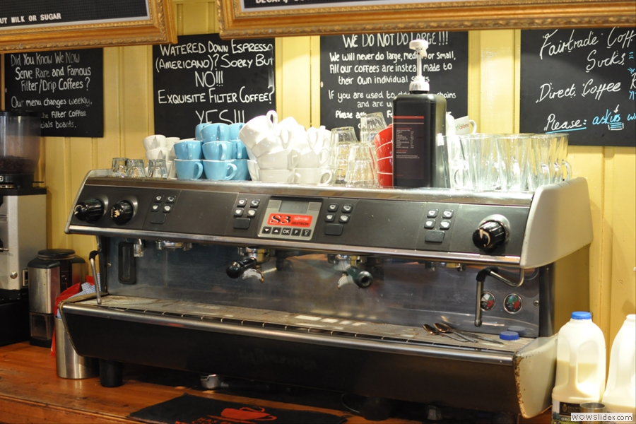 Behind the counter, the espresso machine, a four group monster, takes pride of place.