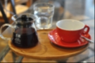 My coffee arrived in a carafe with a bright red cup that matched the colour of the Has Bean bags