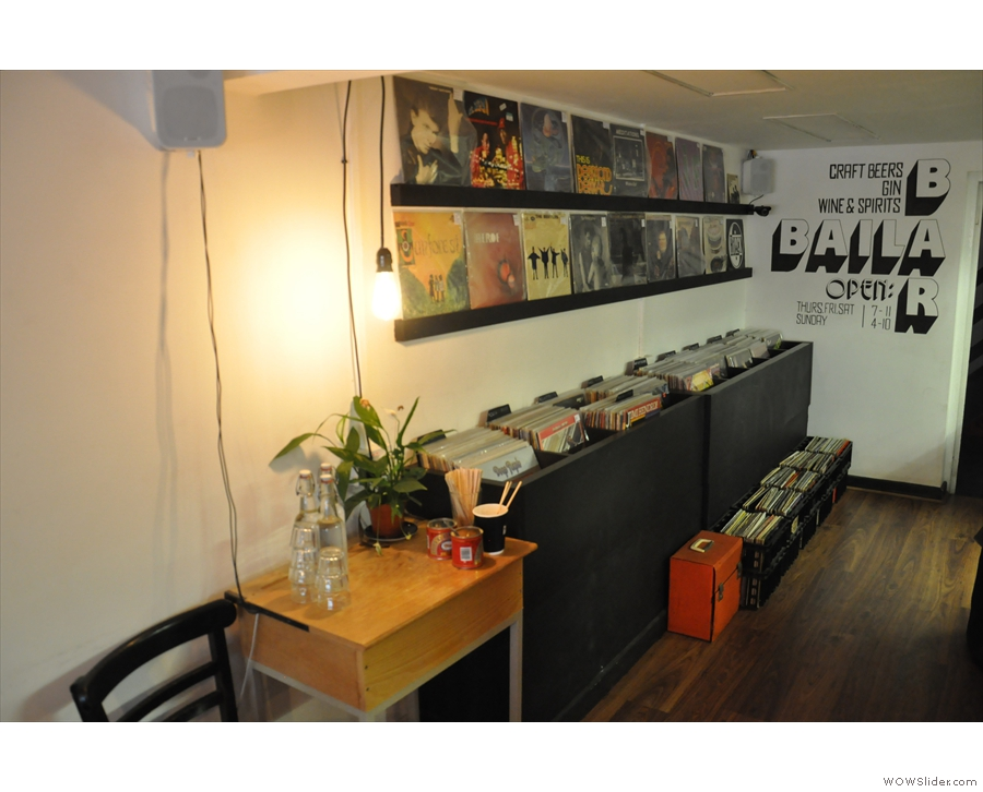 The vinyl part of Baila Coffee & Vinyl is opposite the counter on the left-hand side.