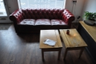 Another view of the sofa, with a pair of old school desks as a coffee table.