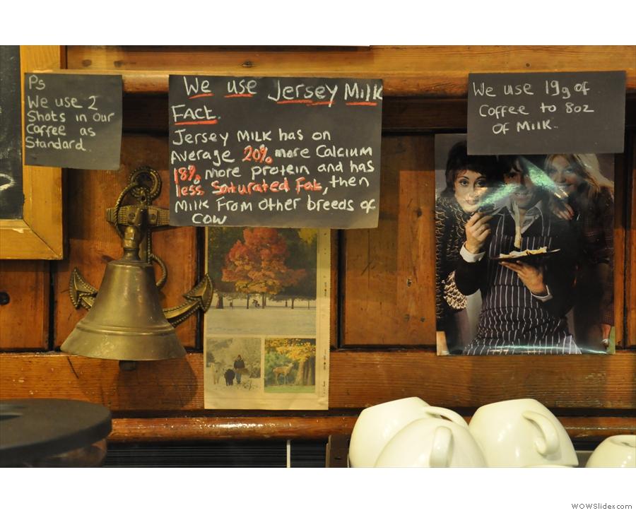 Some informative signs above the espresso machine.