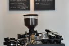 The particular beans (one espresso, one filter) are on the wall at the back of the counter.