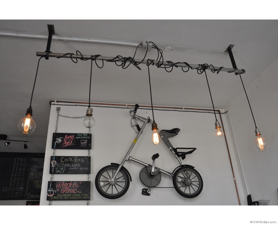 Naturally, there's a folding bike hanging on the wall behind the counter...