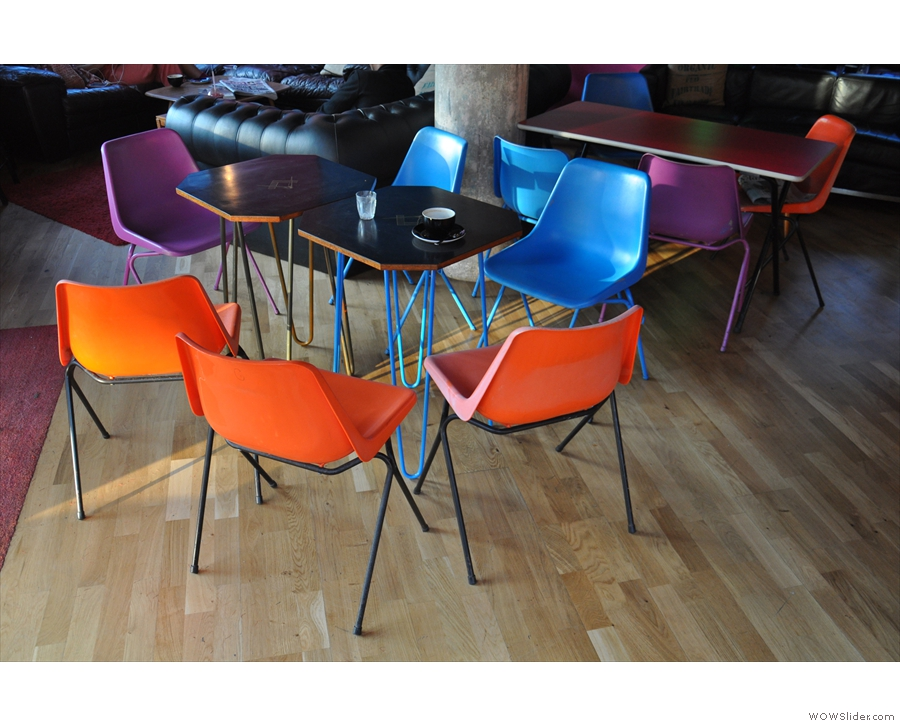 There are these tables, with their mult-coloured bucket-seat chairs (like those outside)...