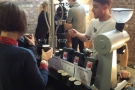 Across the aisle was Square Mile, doing live roasting and proving extremely popular.