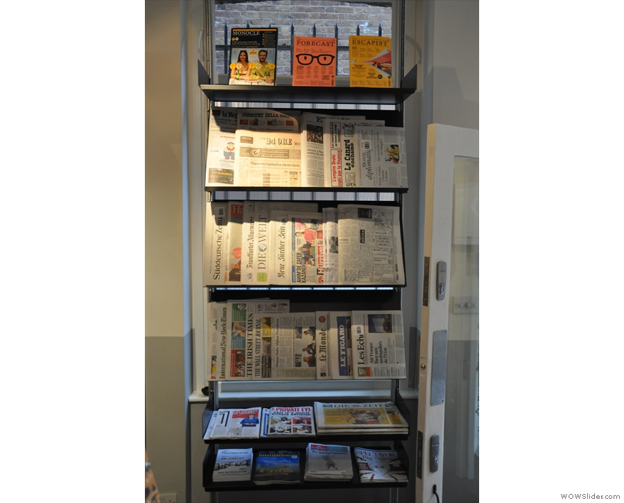 ... while the international papers are on the rack next to the door.