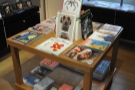 Easier to photograph is the magazine/newsagent side, which is arranged around this table.