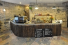 The counter is made of recycled 150 year old wood, plus a bespoke concrete top.