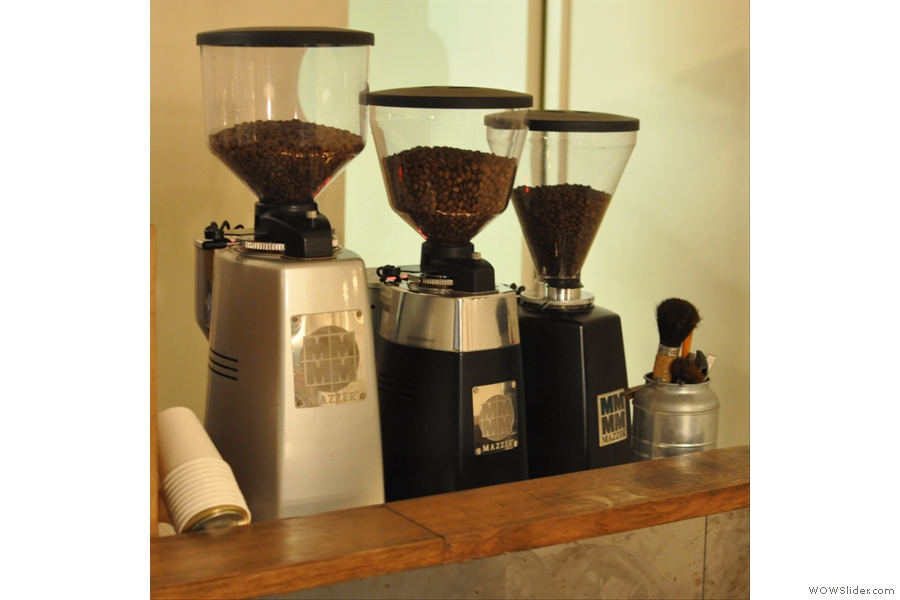 Three grinders, in descending order by size :-) There's a fourth over by the brew bar for grinding the single-origin beans.
