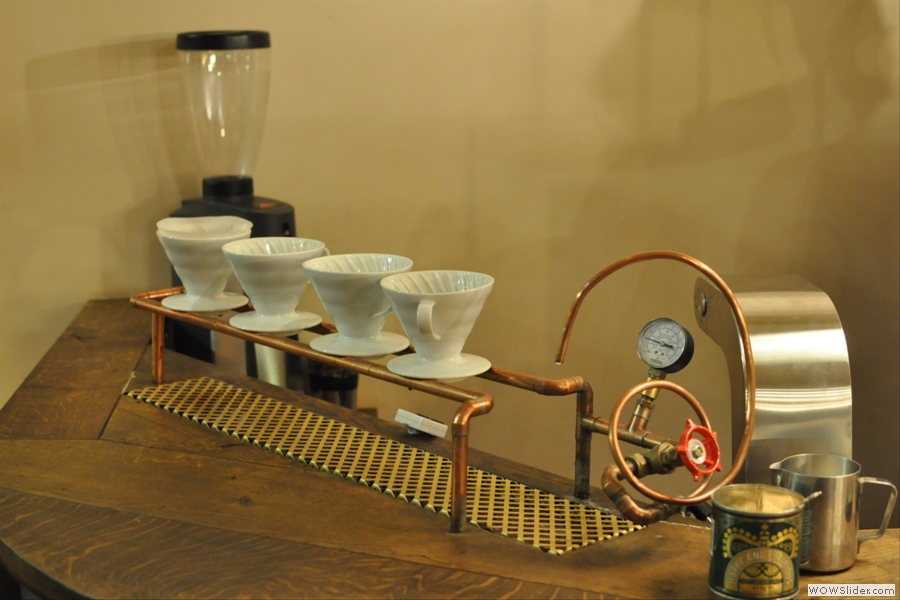 The brew bar, with its own grinder and row of V60s.