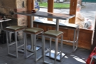 As well as the padded benches by the door, there's also a high table opposite the counter.