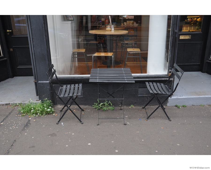 There are two tables like this one outside on the broad pavement.