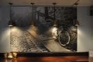 On the back wall, this picture has replaced the mirror. Many of Pave's customers are cyclists.