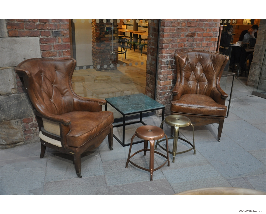 Meanwhile, flanking the door to Ancoats, two lovely pairs of armchairs: these two...