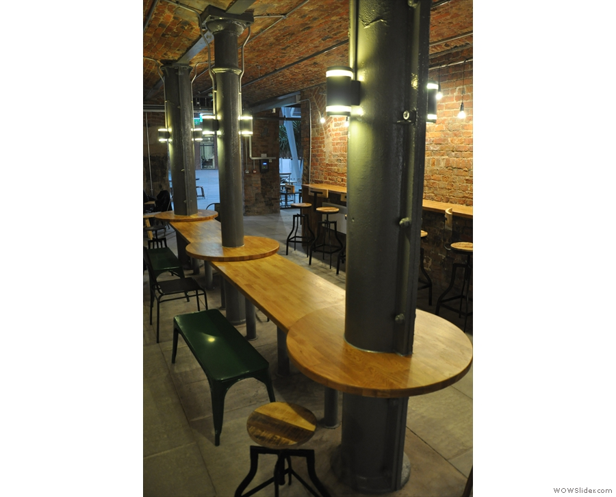 These cast iron pillars hold up the ceiling, so there's not much Ancoats could do about them.