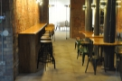 The view from just outside the door, looking down the long bar...