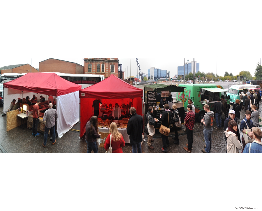 And finally, the street food area outside, doing great business despite the rain!