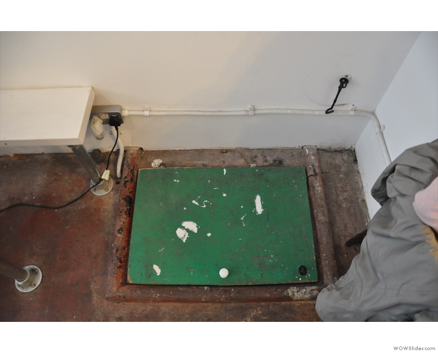 A trap door! For getting rid of awkward customers? No, just the store room/cellar. Pity.