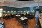 A panoramic view from just inside the door, looking towards the seating arrayed on the left...