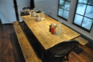 This communal table dominates the space. You can book it if you have group.