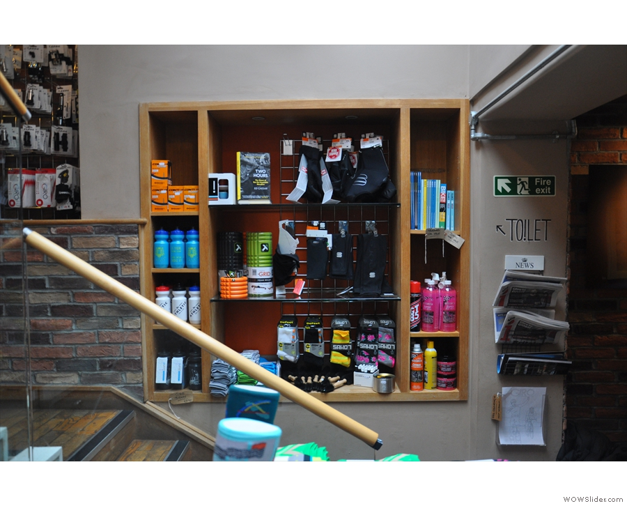 As well as the rack of clothing, there are these shelves of cycling accessories...