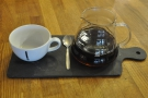 My coffee, beautifully presented on a slate, cup on the side, just how I like it.