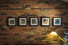 There are quite a lot of pictures on the exposed brick walls...