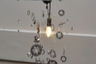The gear-wheel mobile hanging around the solitary light-bulb is also an interesting feature.