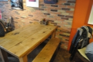 This communal table, complete with benches, is opposite the counter...