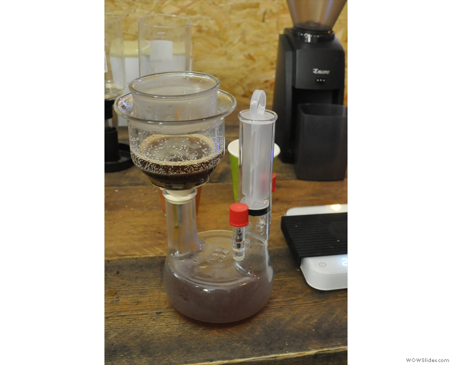 The pumping creates a vacuum, and that draws the coffee through the filter...