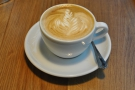 My flat white, with its excellent latte art.