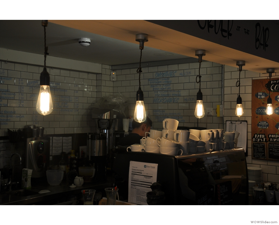 The counter has more traditional light bulbs hanging above it.