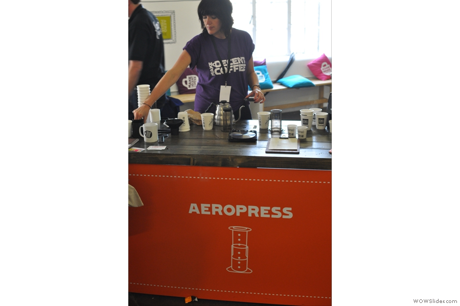 The barista at the Aeropress station gets to work