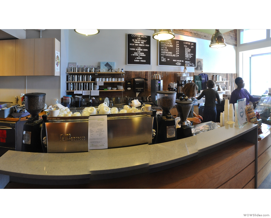 ... and seen here from a slightly different angle, espresso machine flanked by grinders.