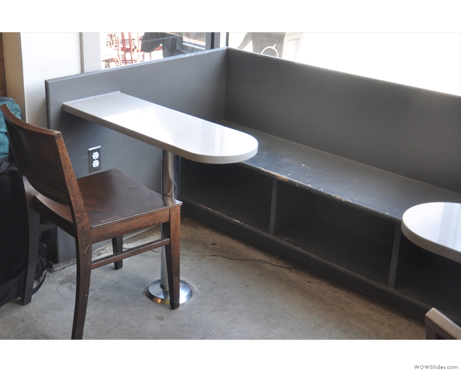 With handy power outlets, it's good for people-watching (chair) and cafe-watching (bench).