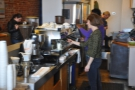 Happy staff make for a happy coffee shop. Here they are making my espresso...