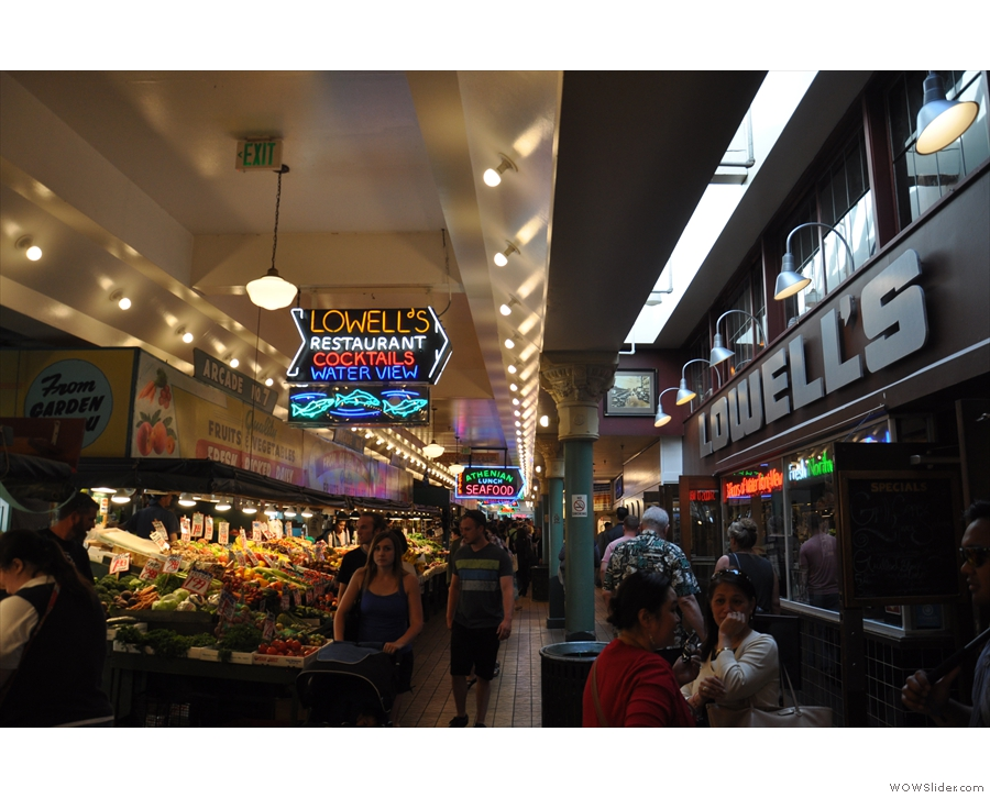 Pike Place Market is a rambling structure with a produce market at street level...