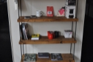 The obligatory shelves of coffee kit and coffee books.