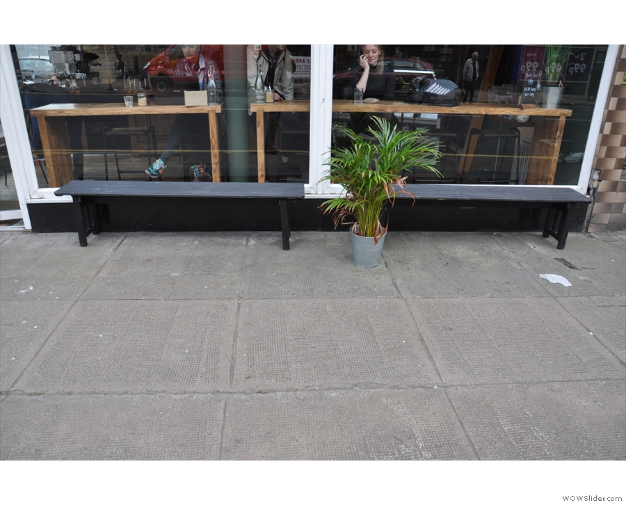 Dumbarton Road is pretty busy, but if you want, you can sit outside on these benches.